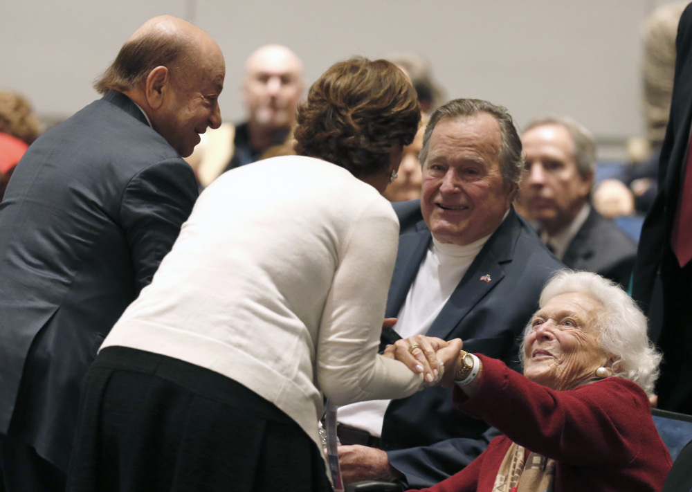 Barbara Bush, right, and former President George H.W. Bush greet friends at his presidential library before their son George W. Bush discussed his new book.