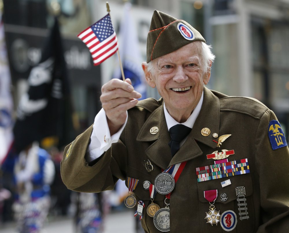 World War II veteran Frederick Carrier, 90, who says he helped liberate the Buchenwald concentration camp, marches up New York's Fifth Avenue on Tuesday.