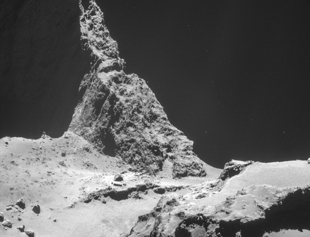 A photograph from the navigation camera on Rosetta shows a region of Comet 67P/Churyumov–Gerasimenko. The 2.5-mile wide comet is about 4.8 miles away in the photo.