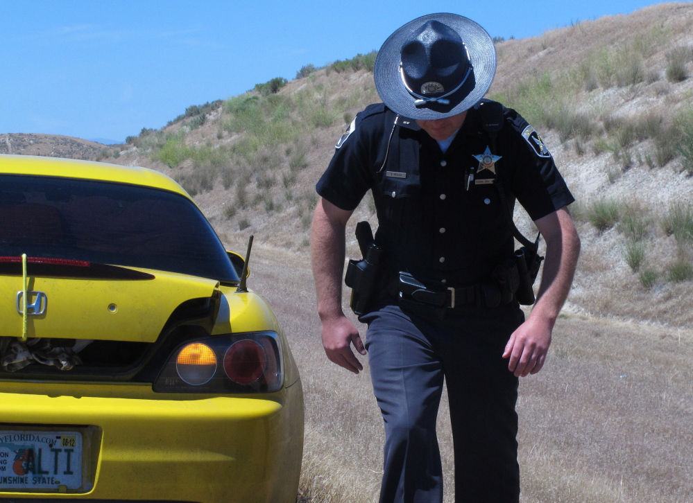 Two California men have filed a federal civil rights lawsuit challenging asset-forfeiture laws after a traffic stop in Iowa. They contend it was part of a pattern connected to the teachings of a private Oklahoma-based police-training company that promotes aggressive tactics.