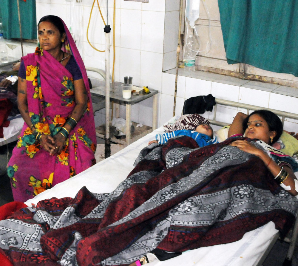 Indian women who were among the 83 who underwent sterilization surgeries receive treatment at the CIMS hospital in Bilaspur, India, on Tuesday. In addition to the 11 women who died, about 20 are seriously ill because of complications after the surgeries.
