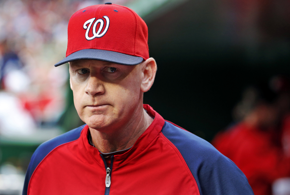 In this June 21, 2014, file photo, Washington Nationals manager Matt Williams walks in the dugout before the Nationals' baseball game against the Atlanta Braves in Washington.