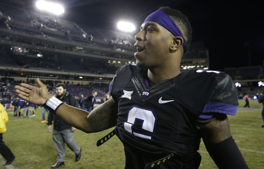 TCU quarterback Trevone Boykin is congratulated as he walks off the field after an NCAA college football game against Kansas State on Saturday in Fort Worth, Texas.