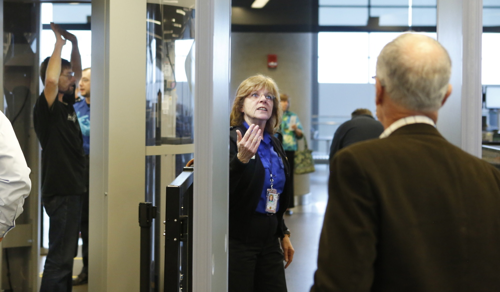 """Suzanne Quintal oversees metal detector screening at the jetport. Jay Brainard of the TSA says his workers have to """"provide good security and excellent customer service."""""""