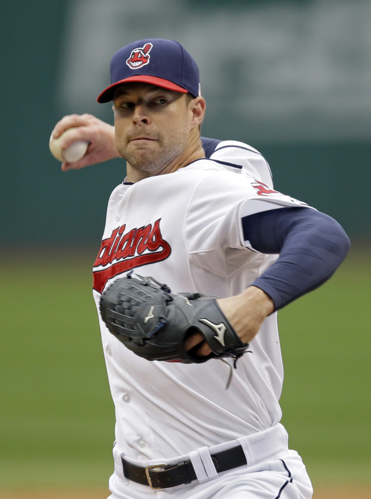 Cleveland Indians pitcher Corey Kluber, seen facing the Minnesota Twins in September, won the American League Cy Young Award, edging Seattle's Felix Hernandez.