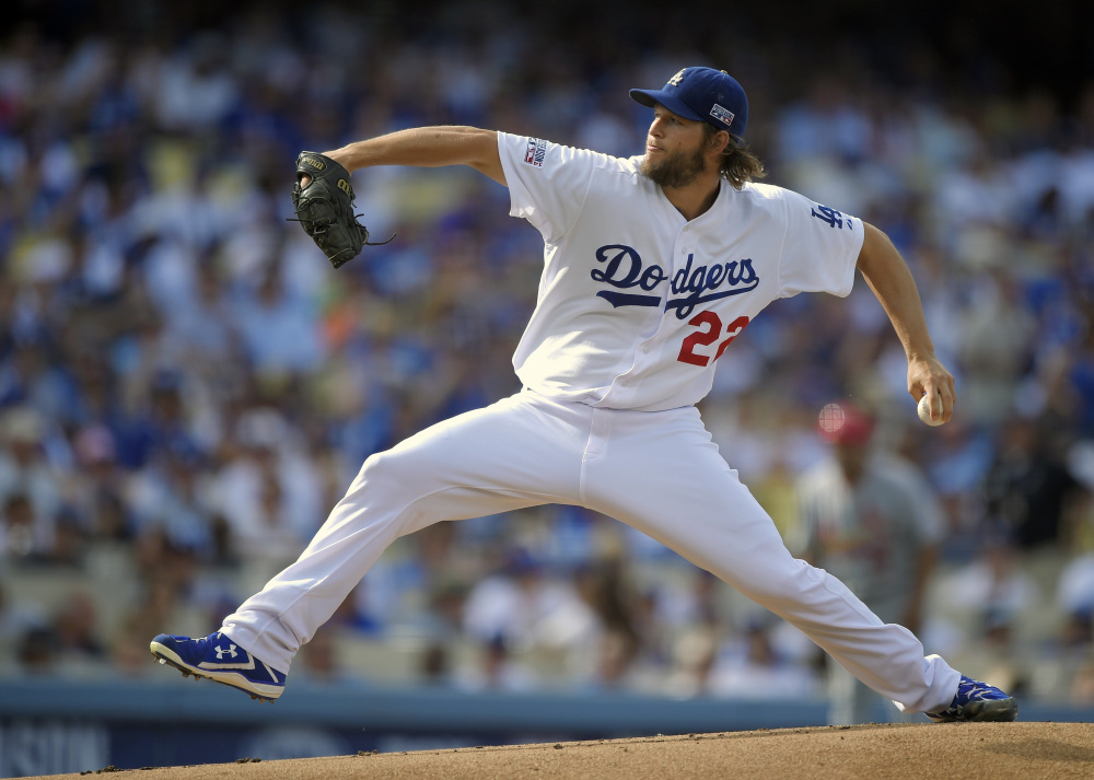 Clayton Kershaw, seen pitching against the St. Louis Cardinals in the NL Division Series last month, was the unanimous winner of his third Cy Young Award after leading the majors in victories and ERA and throwing a no-hitter. Kershaw earned the honor for the second year in a row.
