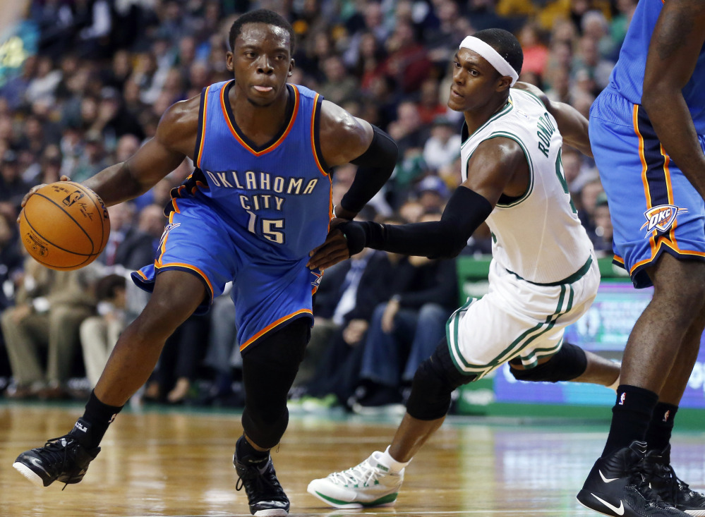 Oklahoma City Thunder guard Reggie Jackson drives against Boston Celtics guard Rajon Rondo during the first half of Wednesday night's game in Boston. Jackson had 28 points in the Thunder's win.