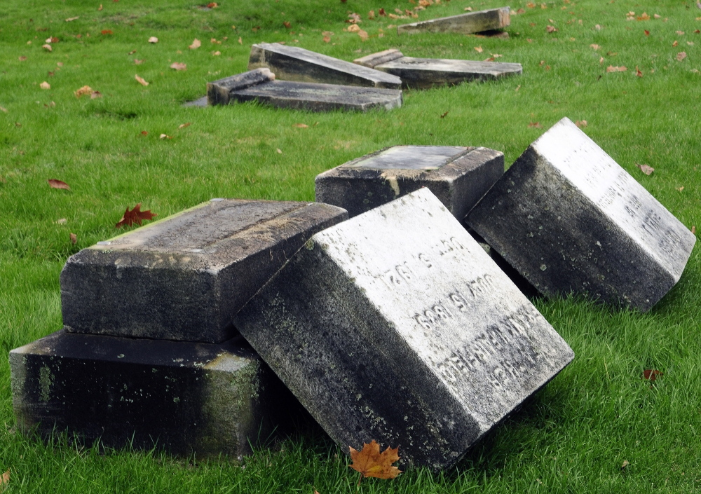 Vandals toppled dozens of headstones at Riverside Cemetery in Augusta sometime Tuesday night or Wednesday morning, police said.