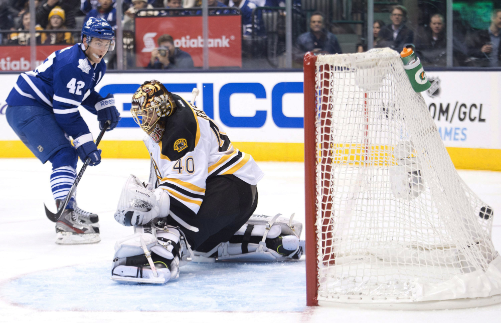 Toronto Maple Leafs forward Tyler Bozak beats Boston Bruins goalie Tuukka Rask for a goal in the second period Wednesday night in Toronto. Rask allowed four goals before being replaced in the second period.