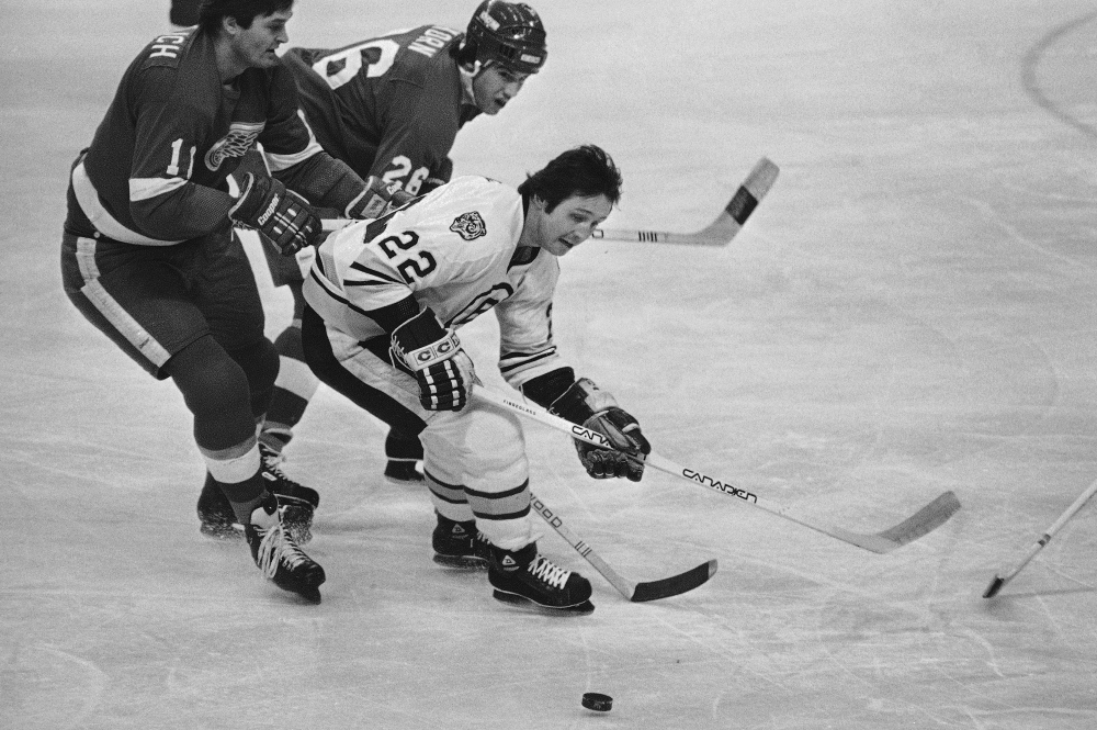 Brad Park skates for the puck as Detroit's Peter Mahovlich (11) and Jim Korn pursue him in a game at the Boston Garden on March 13, 1980. Park, who is 66 now and has a home in Maine, last played in 1985.