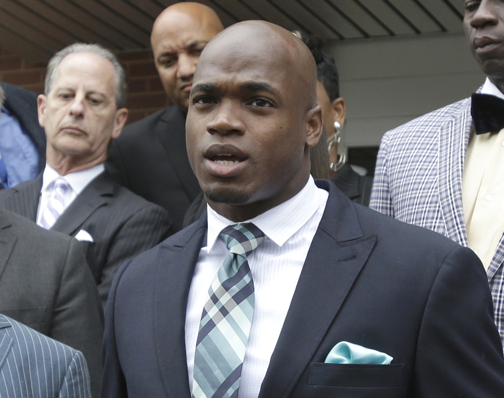 Minnesota Vikings running back Adrian Peterson speaks to the media after pleading no contest on Nov. 4 to an assault charge in Conroe, Texas. Peterson will meet with the NFL on Monday about possible reinstatement with the Vikings.