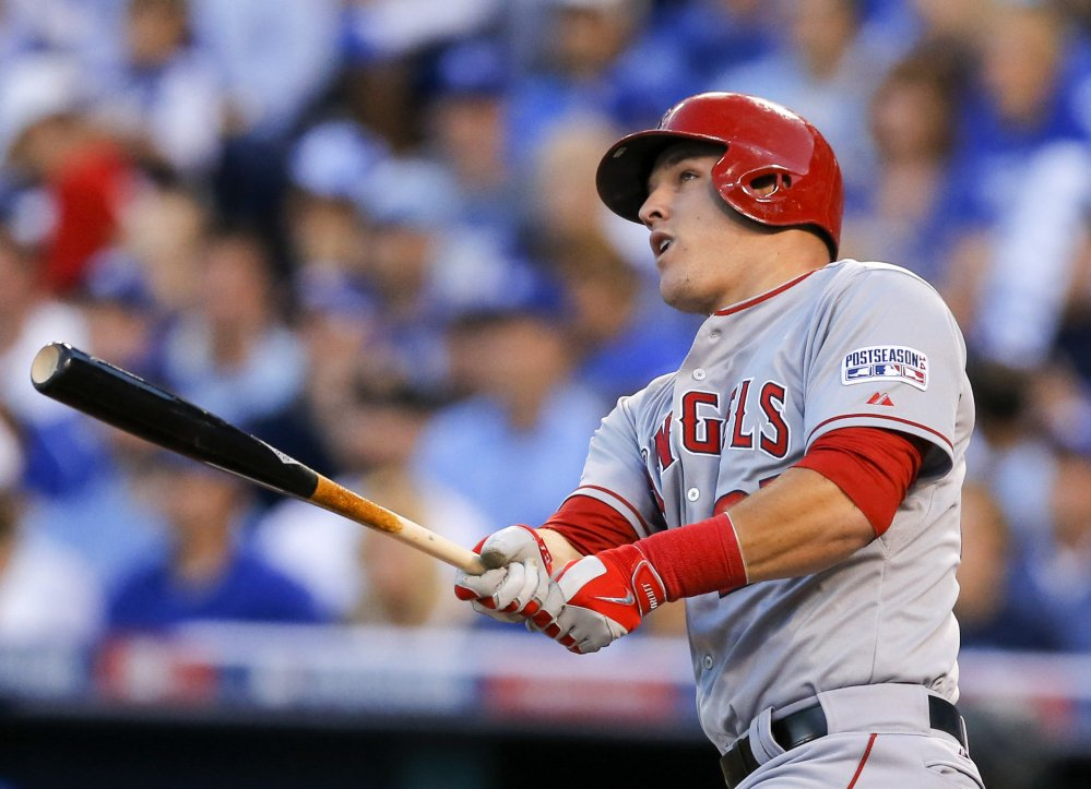 Mike Trout, seen hitting a home run against the Kansas City Royals in the AL Division Series last month, was the unanimous winner of the American League's Most Valuable Player award. At 23, he is the fifth-youngest MVP in major league history.