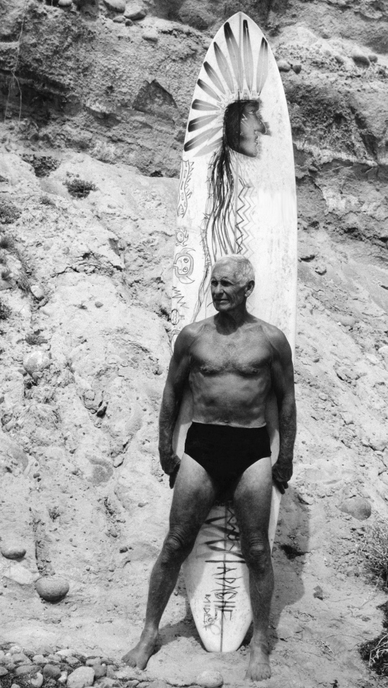 "His face weathered like a seaside bluff and eyes blue like the Pacific, Dorian Paskowitz, seen in this undated image from ""Surfwise,"" was a doctor turned genuine beach boy."