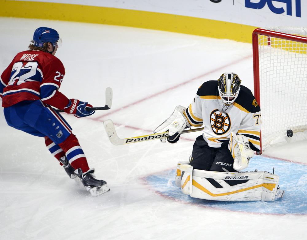 Montreal Canadiens right wing Dale Weise scores against Boston Bruins goalie Niklas Svedberg on a penalty shot during the second period of Thursday night's game in Montreal.