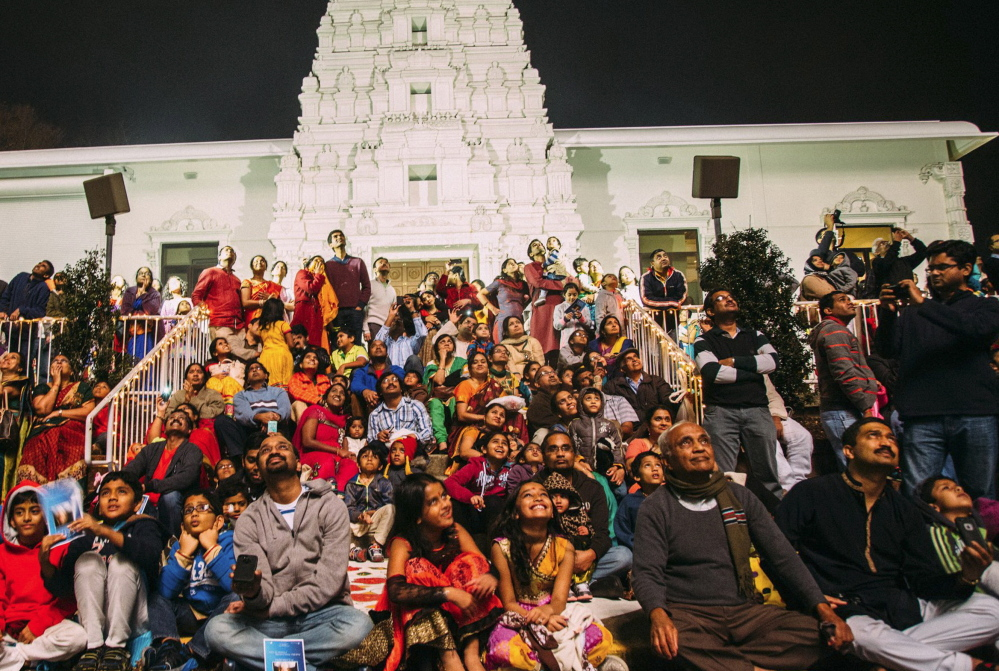 Devotees at the Sri Venkateswara Temple in Penn Hills, Pa., celebrate the Diwali Festival of Lights with a fireworks display in front of the temple.