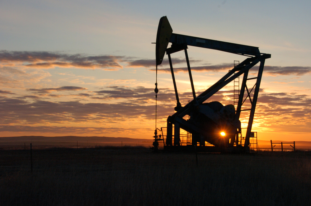 A pump jack pulls crude oil from the Bakken region of the Northern Plains near Bainville, Mont. Discoveries of vast oil reserves and the slow progress of alternatives in recent years has given rise to a very different outlook on oil prices.