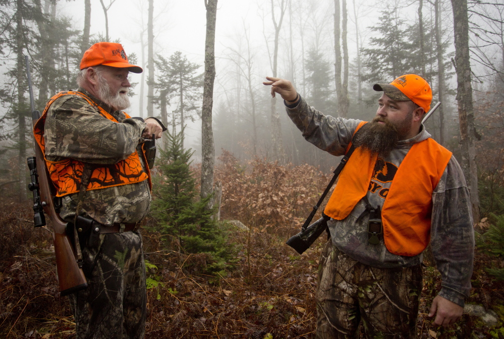 As hunting has grown safer, Maine laws have been relaxed. Now hunters can wear blaze orange in a camouflage pattern and they now are allowed to hunt 30 minutes after sunset during the fading light. The father-son team of John Vogt Sr., left, and John Jr. hunted for moose in November.