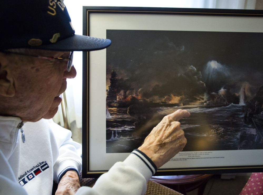Lendall Knight, 95, points out the Japanese battleship Hiei in a painting of the Naval Battle of Guadalcanal that hangs on his wall at an assisted living facility in Cumberland. Knight was a lieutenant in the Navy aboard the USS O'Bannon, which is credited with helping to sink the Hiei 72 years ago.