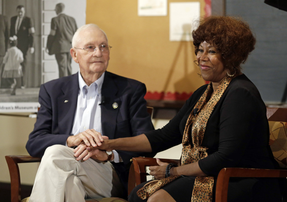 Ruby Bridges, right, who integrated Louisiana schools in 1960 under escort from U.S. Marshals, meets with Charles Burks, who was one of those marshals, in Indianapolis, Ind., on Friday.