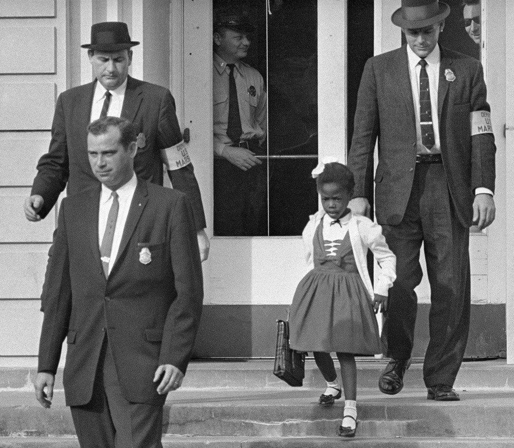 "U.S. Marshals escort 6-year-old Ruby Bridges from William Frantz Elementary School in New Orleans, La., on Nov. 14, 1960. ""Kids come into the world with clean hearts, fresh starts. If we are going to get through our differences, it's going to come through them,"" Bridges said."