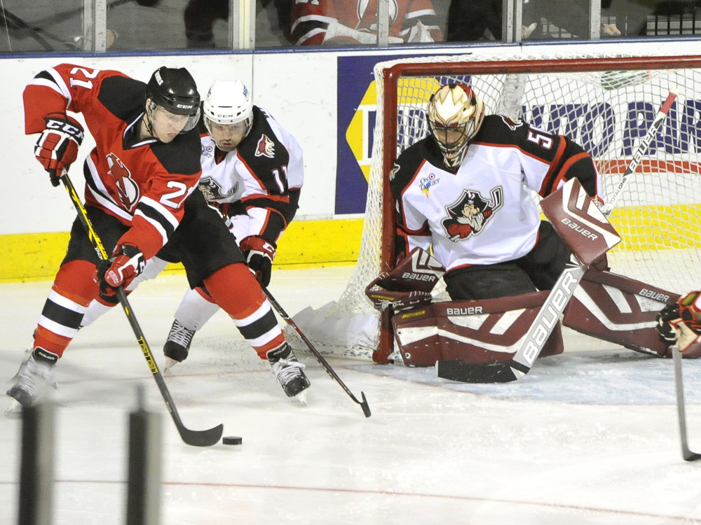 Albany's Graham Black tries to score as Portland's Francis Wathier and goalie Mike McKenna make the stop in the Pirates' loss to the Albany Devils on Friday night at the Cross Insurance Arena in Portland.