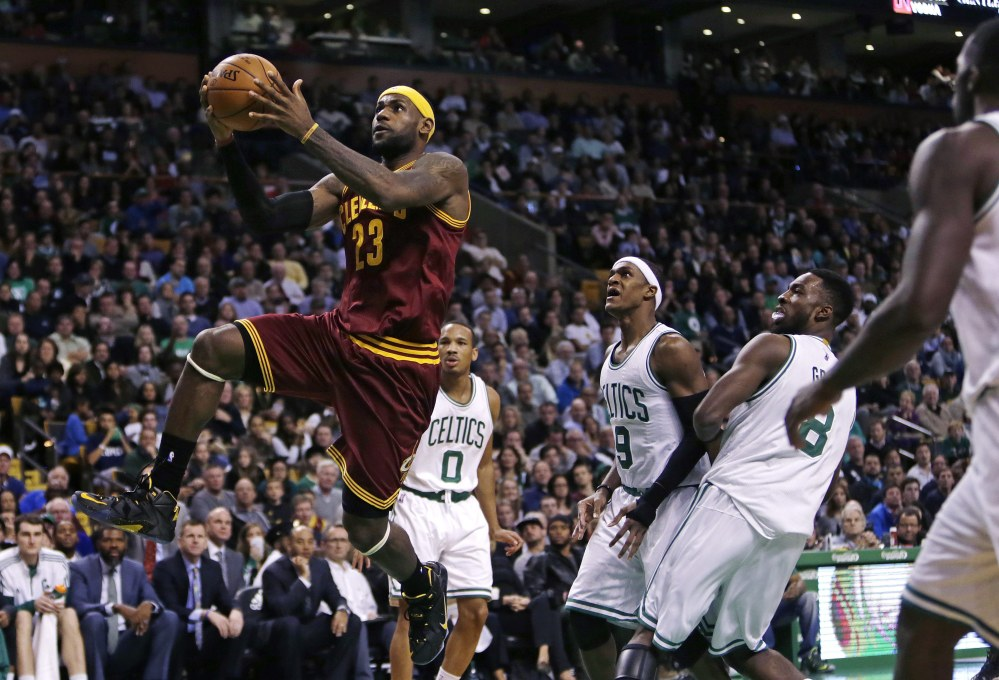 Cleveland's LeBron James drives through the Boston Celtics' defense during the second half of Friday night's game in Boston. James scored a season-high 41 points as the Cavaliers beat the Celtics, 122-121.