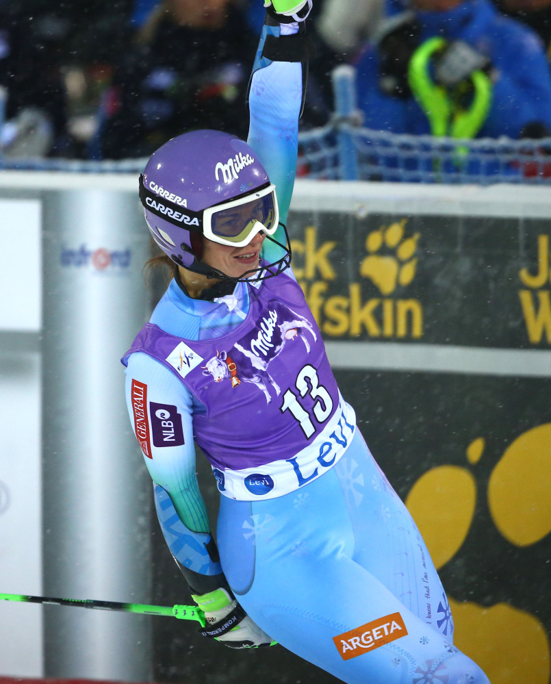 Tina Maze celebrates in the finish area after winning the World Cup slalom opener, in Levi, Finland, on Saturday.