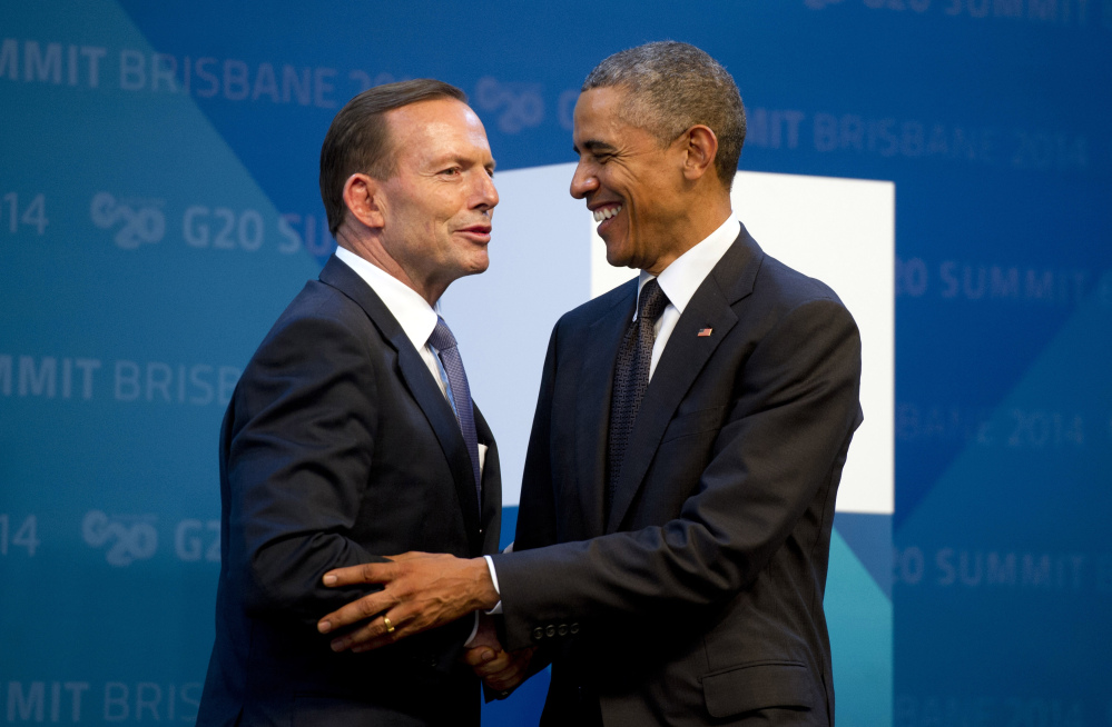 U.S. President Barack Obama, right, is welcomed by Australia's Prime Minister Tony Abbott upon arrival for the G20 Summit in Brisbane, Australia, on Saturday.