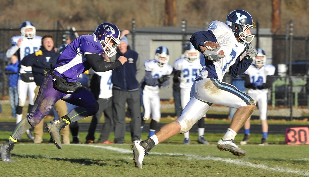 York #7, Jordan Pidgeon, takes the ball all the way to a second touchdown, for a comeback by York in the final minutes as Marshwood beats York in the finals of the Western Class B Football Championship. Gordon Chibroski/Staff Photographer