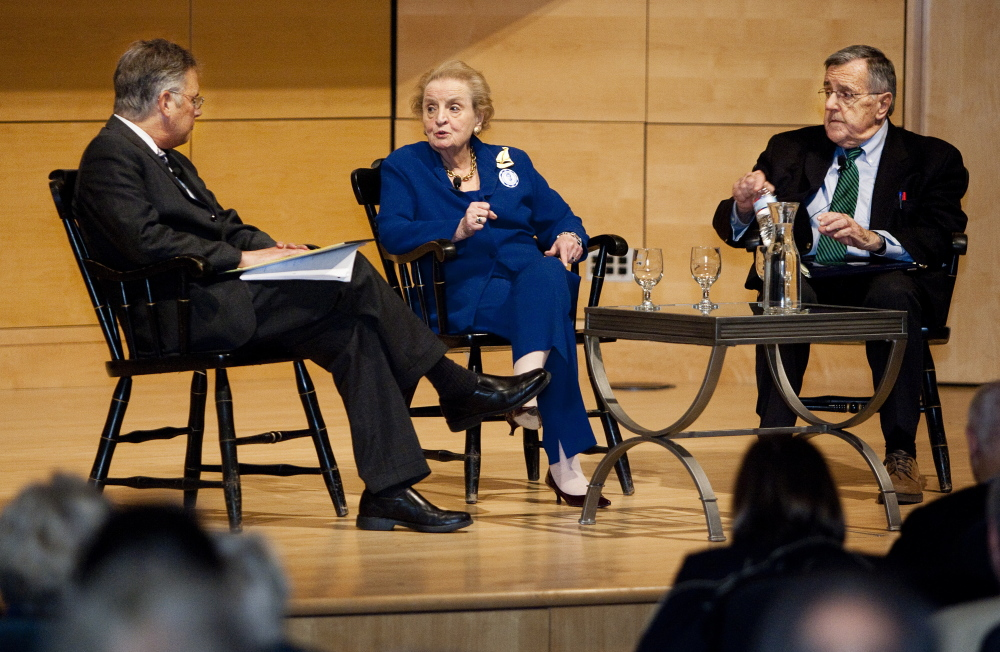 Former Secretary of State Madeleine Albright speaks with Joel Goldstein, left, as political analyst Mark Shields listens during a tribute to Edmund Muskie on Saturday.