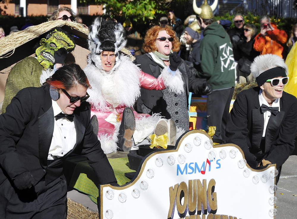 "The team from the Maine State Music Theatre's production of ""Young Frankenstein"" won the best bed award in the Rolling Slumber Bed Races in Park Rowe in Brunswick on Saturday."