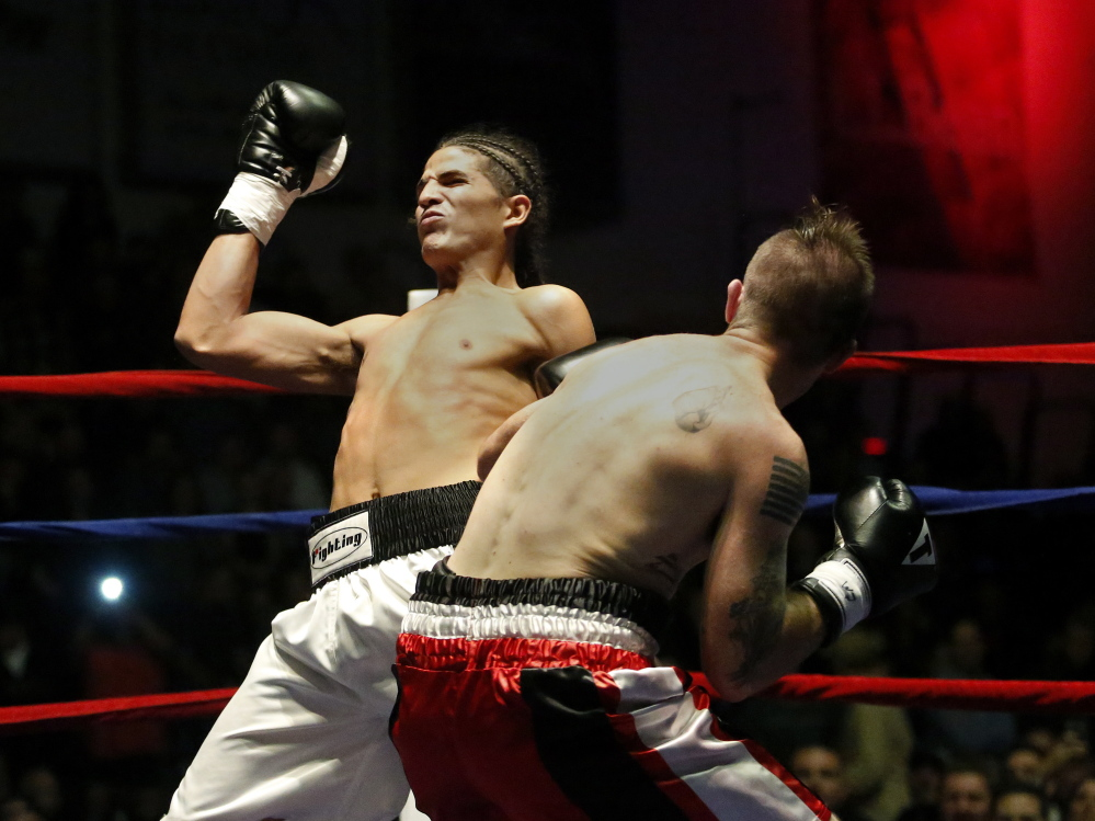 Jason Quirk of Scarborough delivers a blow to his opponent Brian Diaz during a middleweight bout at the Portland Expo. Quick won when Diaz quit in the first minute.