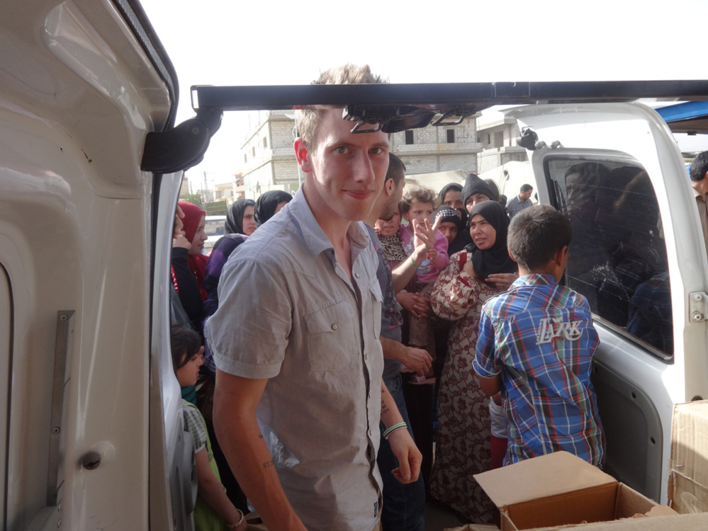 This undated photo provided by the Kassig Family shows Peter Kassig delivering supplies for Syrian refugees. A new graphic video purportedly produced by Islamic State militants in Syria released Sunday claims U.S. aid worker Kassig was beheaded.