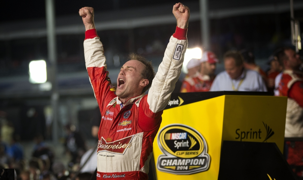 Kevin Harvick celebrates winning the NASCAR Sprint Cup championship series auto race Sunday in Homestead, Fla.