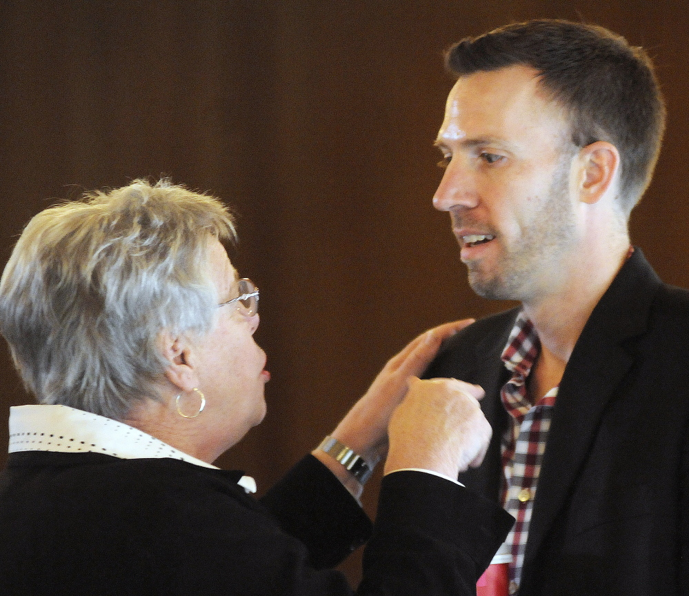 Phil Bartlett, right, of Gorham, speaks with Maine Democratic Party Vice-Chairwoman Pam Fenrich during a meeting in Augusta on Sunday to elect a new chairman of the party. Bartlett won the position by a large margin.
