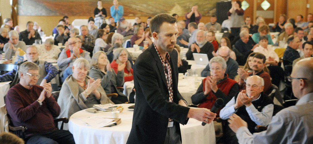 Philip Bartlett, 38, of Gorham takes the floor to address members of the Maine Democratic Party State Committee during a meeting in Augusta on Sunday to elect a new chairman for the party. .