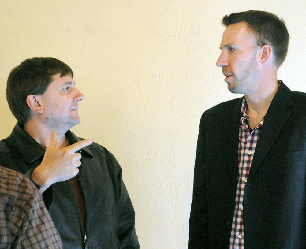 State Senator Troy Jackson, D-Allagash, left, speaks with Philip Bartlett of Gorham, during a Maine Democratic Party meeting in Augusta on Sunday. Jackson nominated Bartlett to be the next chairman of the party.