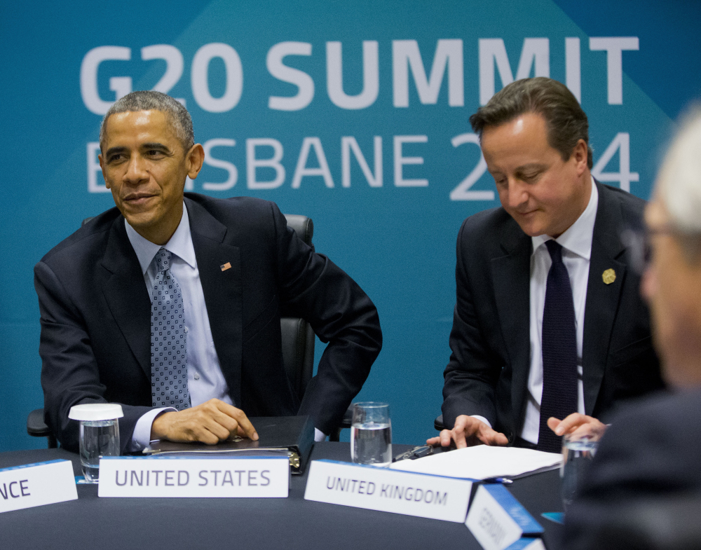 President Obama and British Prime Minister David Cameron, right, meet with other European leaders at the G20 Summit to discuss transatlantic trade Sunday in Brisbane, Australia. The Associated Press