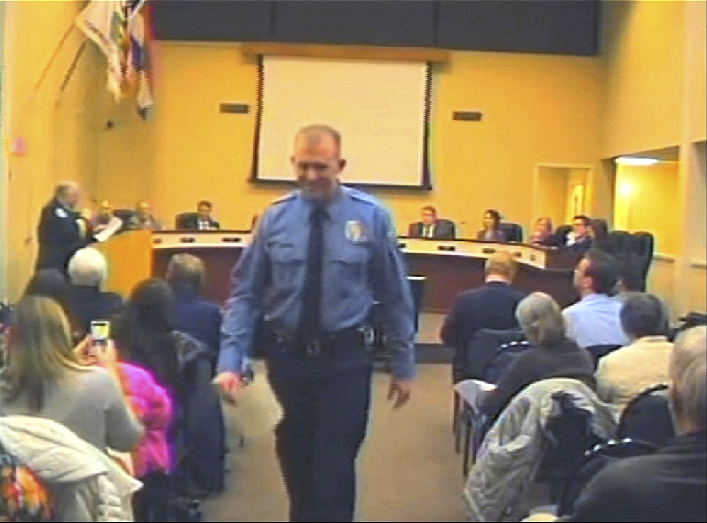 Officer Darren Wilson attends a city council meeting in Ferguson, Mo. His shooting of 18-year-old Michael Brown on Aug. 9 is just one of many cases that lead to questions about the use of lethal force by law enforcement personnel.