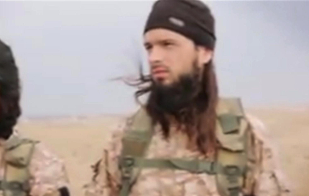 This still image taken from an undated video published on the Internet by the Islamic State group and made available Sunday shows a militant who the French government says is Frenchman Maxime Hauchard.