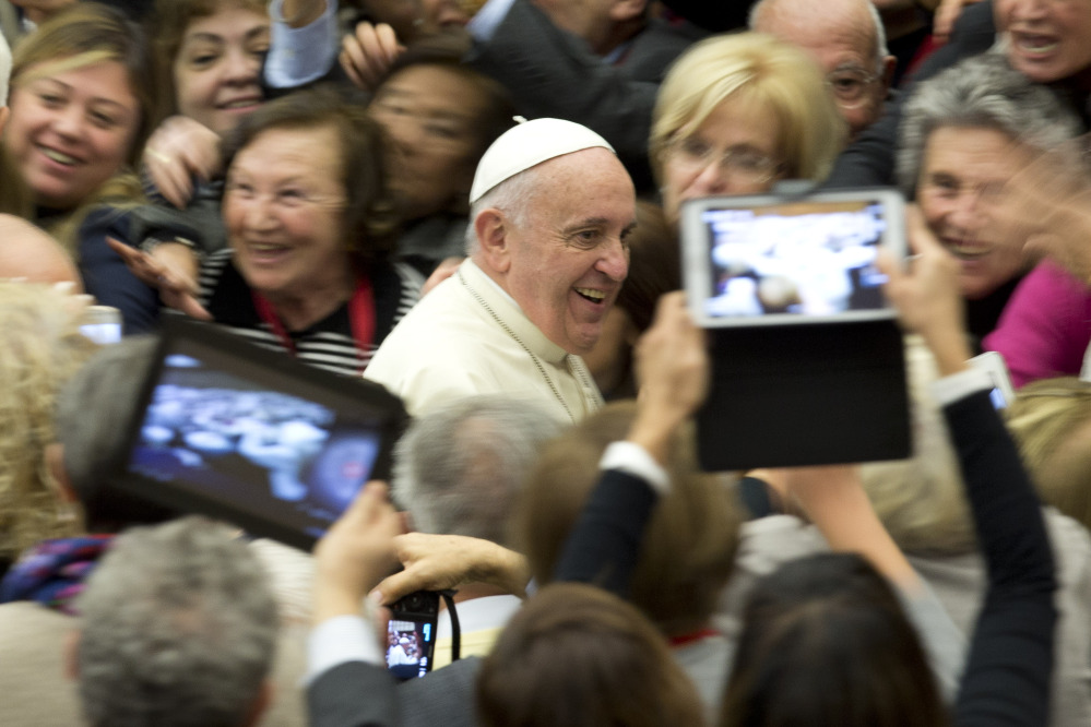 Pope Francis arrives for a special audience for members of Catholic medical associations at the Vatican on Saturday. He has confirmed that he will visit the United States next year.