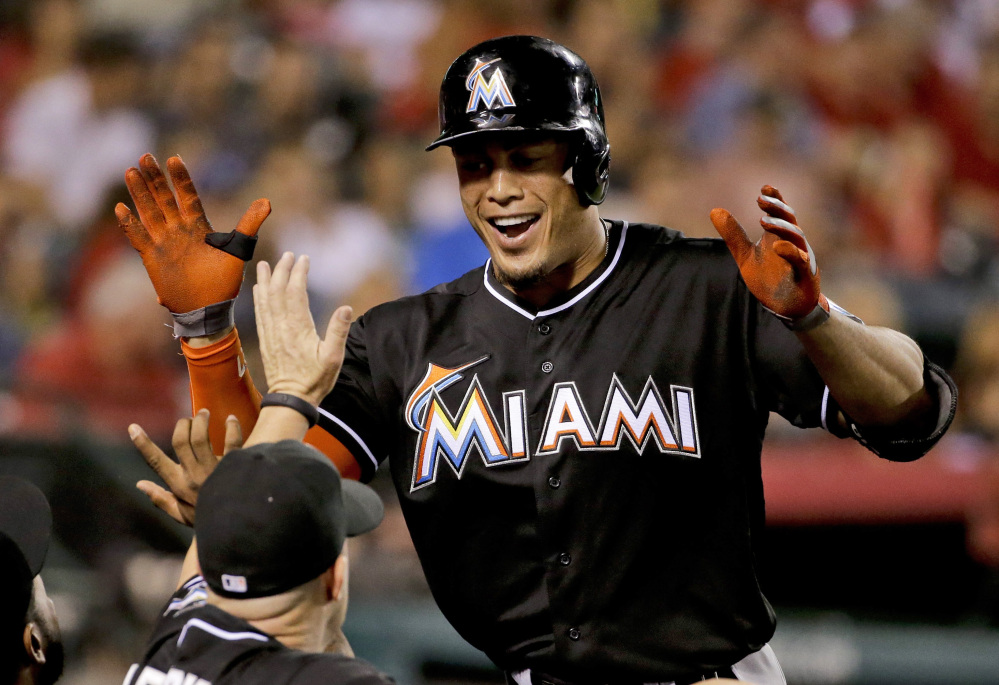 Miami's Giancarlo Stanton, whose season ended on Sept. 11 when he was hit in the face by a pitch, still led the National League with 37 home runs and a .555 slugging percentage.