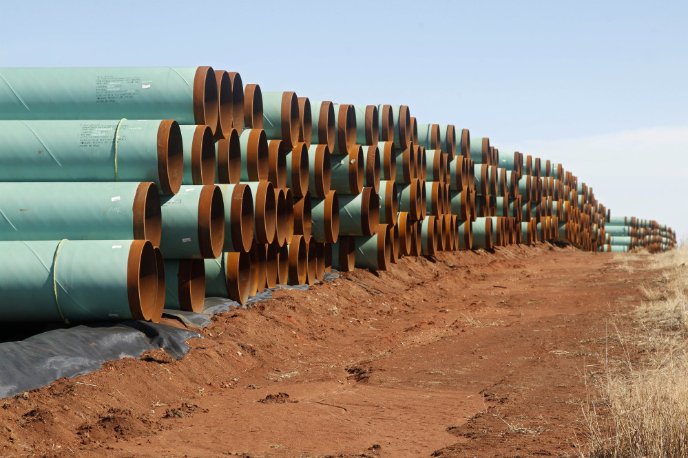 Miles of pipe ready to become part of the Keystone Pipeline are stacked in a field near Cushing, Okla.