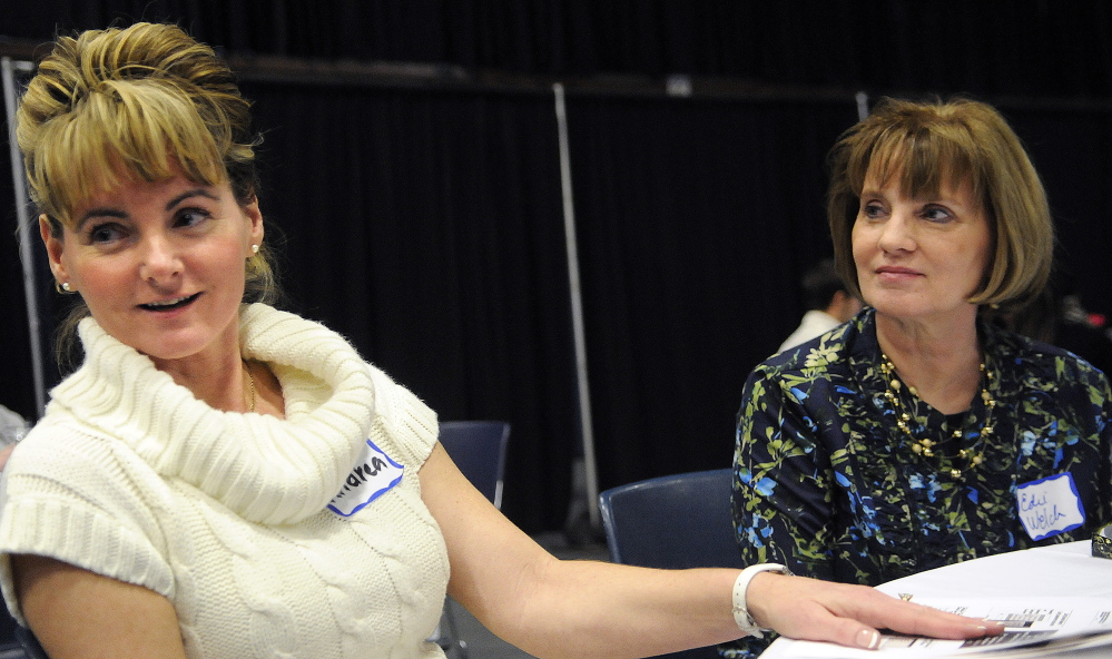 MaineGeneral nurse Andrea Ando-Albert of Manchester, left, and nurse manager Edie Welch of Belgrade discuss how they integrate compassion and love into their care during a nursing convention Monday in Augusta.