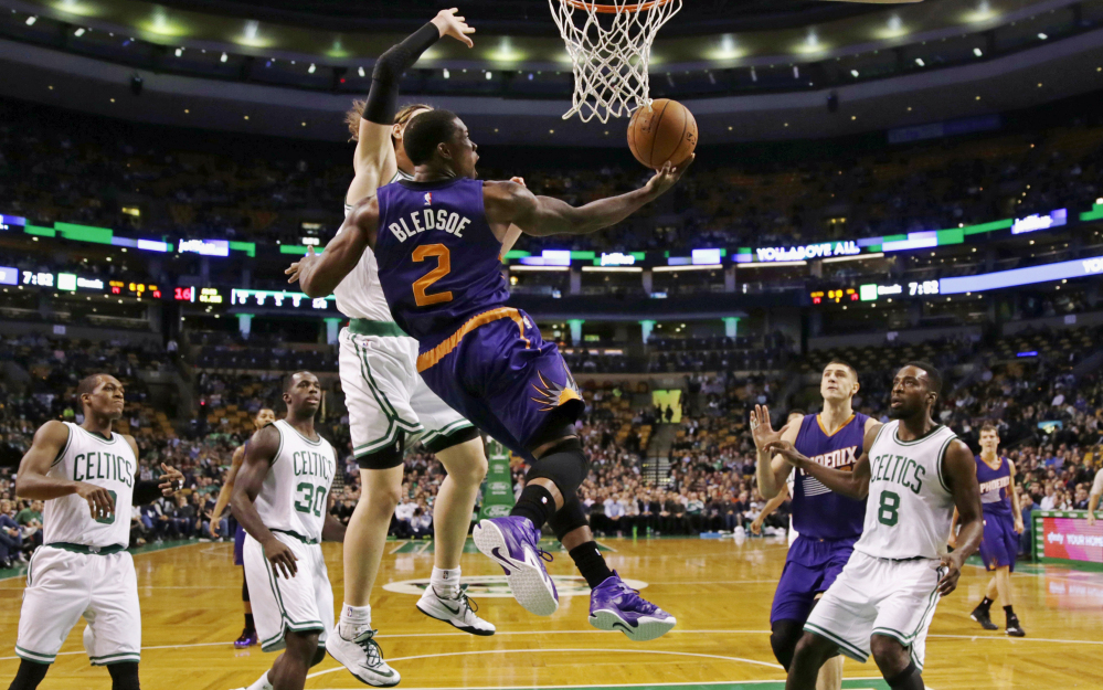 Phoenix Suns guard Eric Bledsoe takes a reverse lay-up after passing the Boston Celtics on a drive to the basket during the first quarter of Monday night's game in Boston. Bledsoe made the game-winning play for the Suns in the last minute.