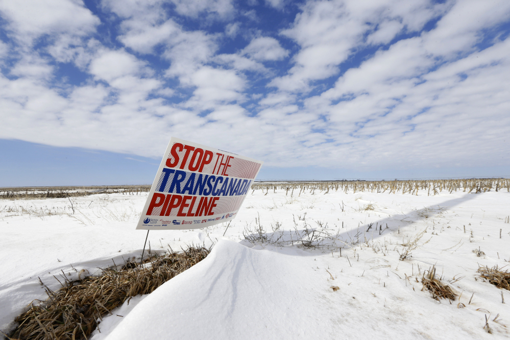 "A sign reading ""Stop the Transcanada Pipeline"" stands in a field near Bradshaw, Neb., along the Keystone XL pipeline route through the state. With the clock ticking, supporters of a Senate bill to approve the Keystone XL pipeline are still scrambling to find the last vote."