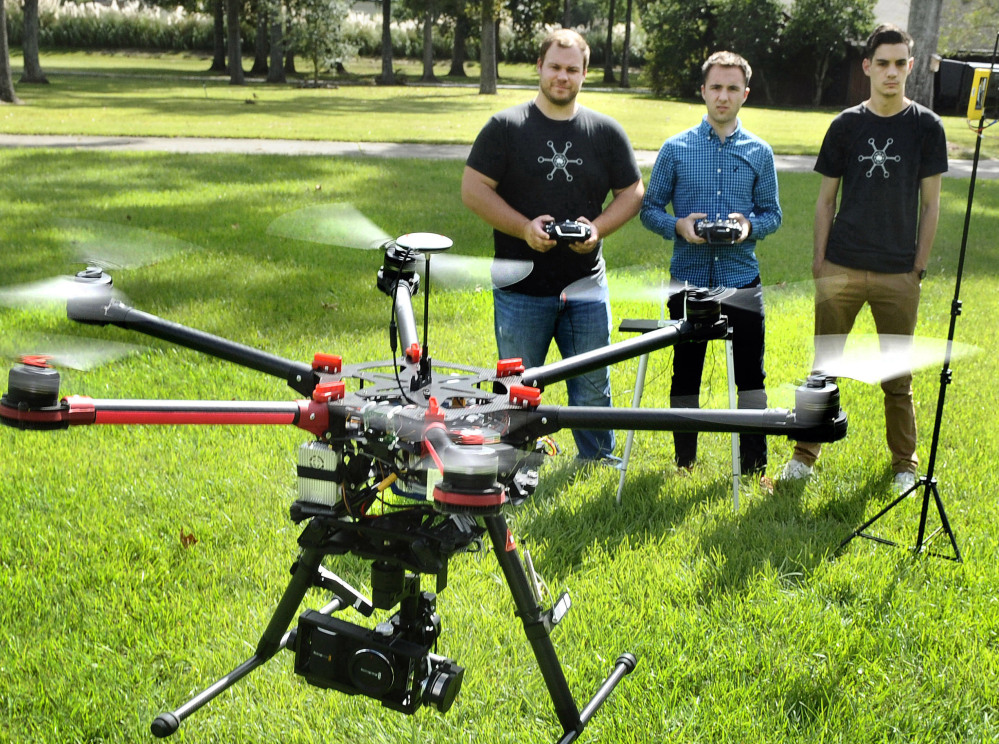 Paul Charbonnet, left, of Atmosphere Aerial in Louisiana, demonstrates a drone aircraft. Drones have become very popular for aerial photography, but have also spurred debate about the safety and regulation of these aircraft.