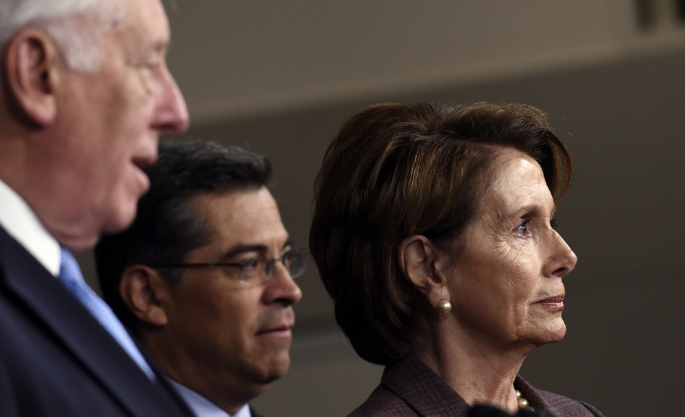House Minority Leader Nancy Pelosi of Calif., right, and Chairman of the Democratic Caucus Rep. Xavier Becerra, D-Calif., center, listen as House Minority Whip Steny Hoyer of Md., left, speaks during a news conference Tuesday on Capitol Hill in Washington, to introduce the Democratic leadership team for the 114th Congress.