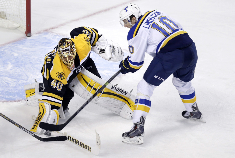 Boston goalie Tuukka Rask makes a save on a shot by St. Louis Blues left wing Joakim Lindstrom during the third period Tuesday night. Rask shut out the Blues in a 2-0 win.