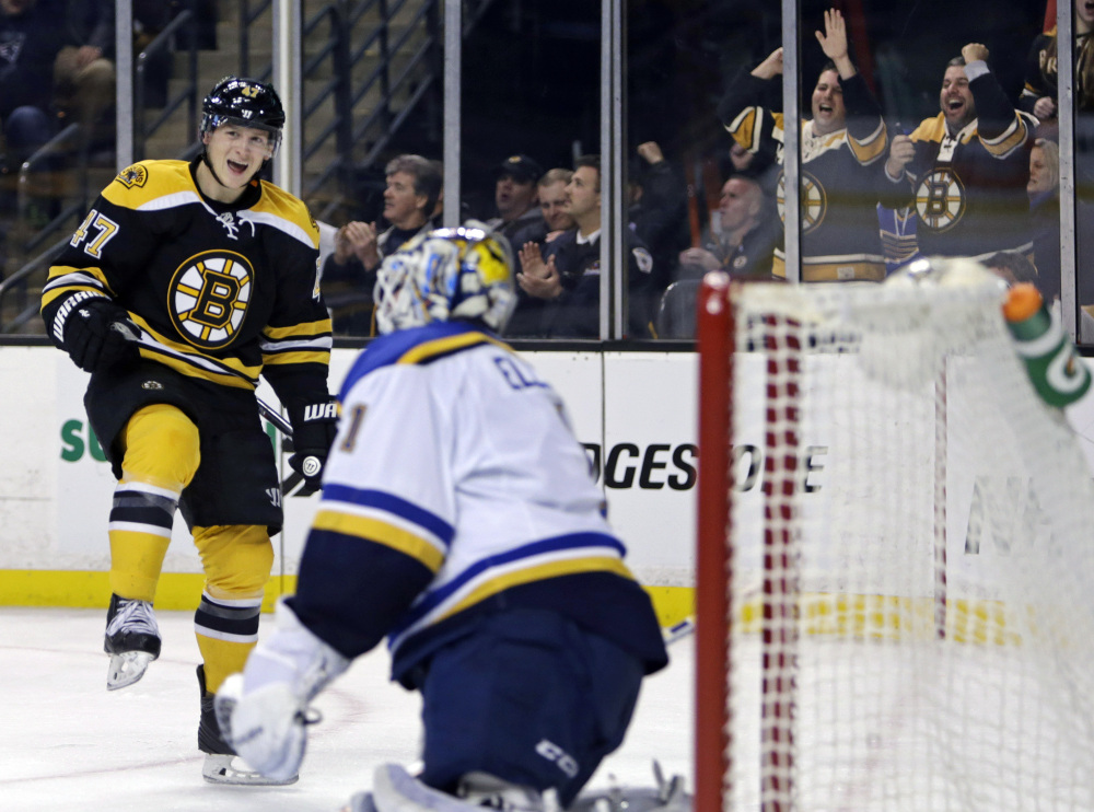 Bruins defenseman Torey Krug celebrates his goal against St. Louis Blues goalie Brian Elliott during the second period of Tuesday night's win for Boston.